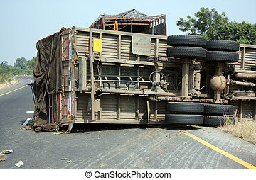 Truck Accident - A view of the rear wheels of a skidded...
