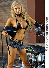 Sexy motorcycle biker girl wearing leather