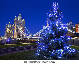 Tower Bridge and Christmas Tree in London - LONDON, UK -...