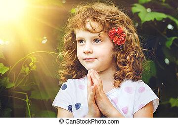 Praying little girl - Little girl folded her hands in...