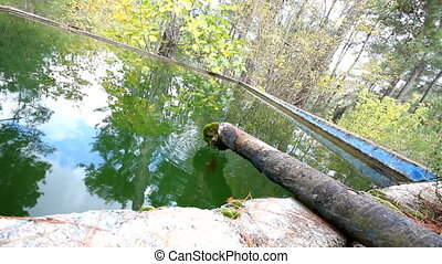 green piping fresh water reservoir - water from mountains is...