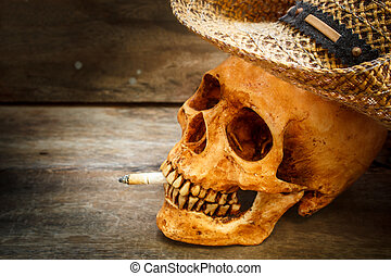 Skull with cigarette, still life. - Skull with cigarette,...