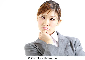 businesswoman thinks - studio shot of young Japanese...