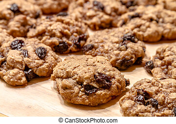 Making of Oatmeal Raisin Cookies - Close up of rows of...