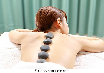 stone therapy  - Woman receiving a therapy at the health spa