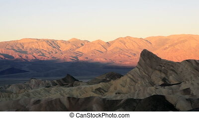 Sunrise Badlands Amargosa Mountain - The sun come up to...