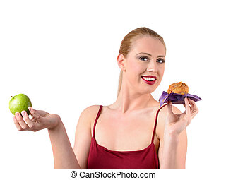 choosing between healthy and fatty food - young woman...