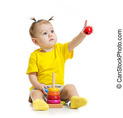 baby playing with colorful toy and pointing by finger...