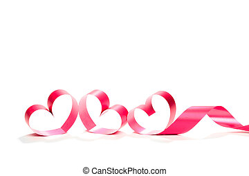 red heart ribbon isolated on white background. studio shot