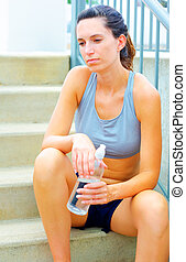 Urban Mature Woman Exercising - Mature woman working out in...