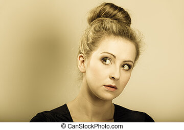 girl blonde woman in hair bun - Portrait of young beautiful...