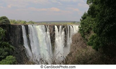 The Victoria falls with mist - The Victoria falls is the...