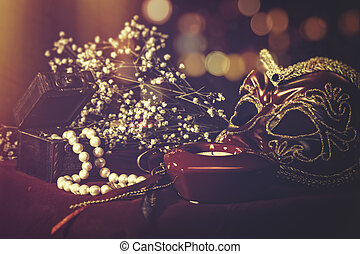 Vintage still life with old mask and pearls for your design