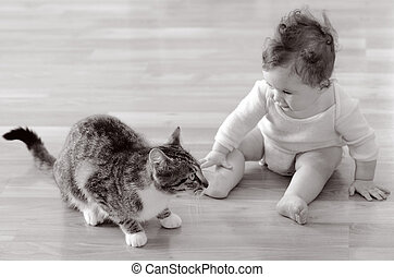 Baby plays with animal - Baby (girl age 06 months) sits and...