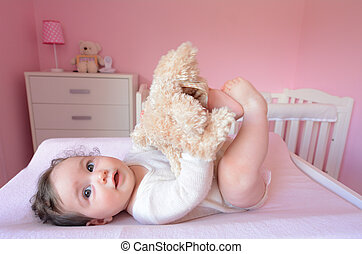 Baby plays with soft toy - Baby (girl age 06 months) plays...