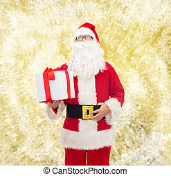 man in costume of santa claus with gift box - christmas,...