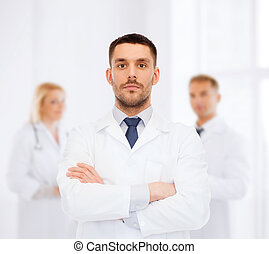 male doctor in white coat - healthcare, profession and...
