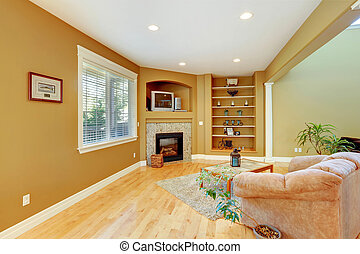 Cozy sitting area with fireplace, comfortable armchair and...