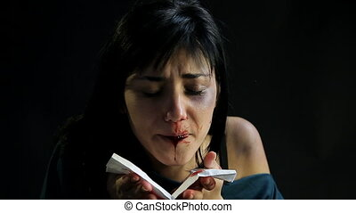 Woman spitting blood after violence - Woman desperate after...