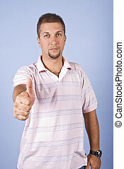 Mid adult man giving thumbs up - Portrait of mid adult man...