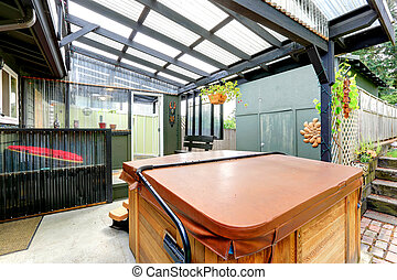 Covered pergola with jacuzzi and exit to backayrd area