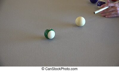 pool player at billiard table
