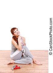 woman resting after work out - studio shot of woman resting...