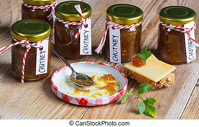 Onion pineapple chutney on rustic wood.