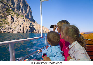 Sea sightseeing - family on marine walk on excursion ship...
