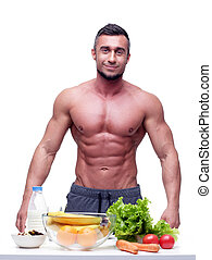 Portrait of a smiling muscular mn with healthy food