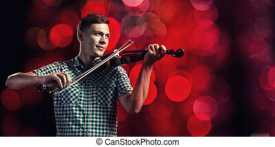 Musician playing violin - Young handsome guy in shirt...