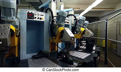 Modern machine in workshop of footwear production - View of...