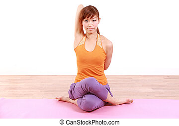 YOGA quot;cow face posequot; - example shot of yoga pose by...