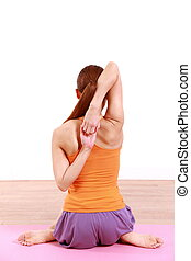 "YOGA ""cow face pose"" - example shot of yoga pose by young..."