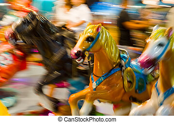 carrousel - a colorful photo of horse of a carrousel