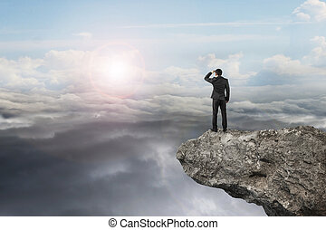 businessman looking on cliff with natural sky daylight...