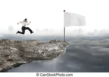man running to white flag on cliff with cloudy cityscape -...