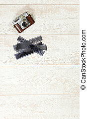 Vintage photography background with a retro rangefinder and...