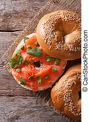 Traditional bagel with salmon and cream cheese top view...