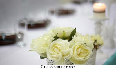 Beautiful lighted candles on the wedding table