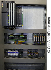 Automation with PLC and relays in industrial process.
