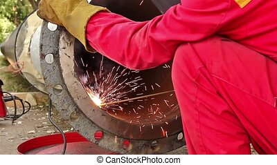Metalworker working on a pipeline - Welder welding a pipe on...