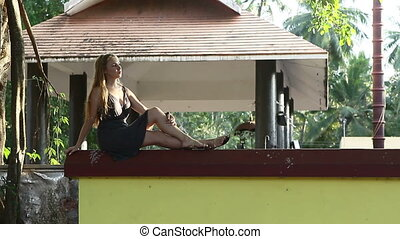young beautiful blonde girl - girl sitting on the fence...