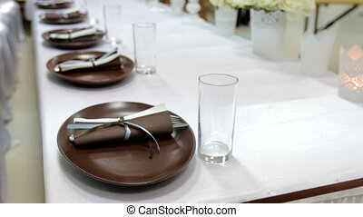 Plates and glasses on wedding table