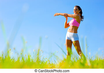 Athletic Woman Exercising - Athletic woman working out in a...