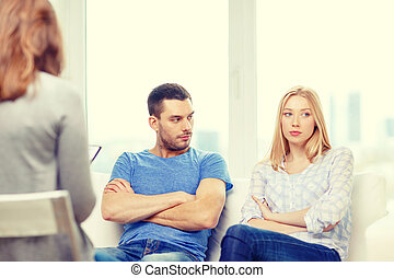 young couple with a problem at psychologist office - love,...