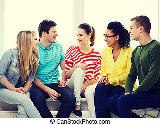 five smiling teenagers having fun at home - education,...