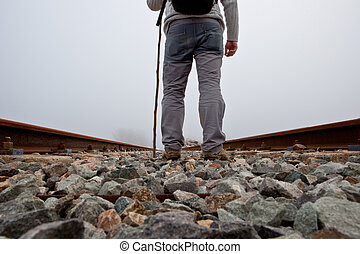 Trekker on railway - A man walking on the tracks with cane...