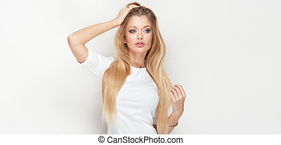 Girl with long healthy hair - Attractive blonde woman posing...