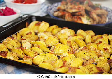 potato and fat on a baking sheet - potato and fat stew in...